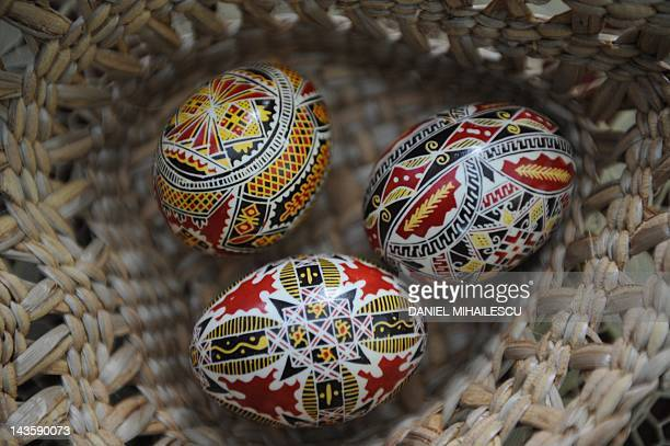Decorated eggs using beeswax and red dye are pictured on April 13 in Niculesti village Millions of Orthodox Christians are celebrating Easter over...