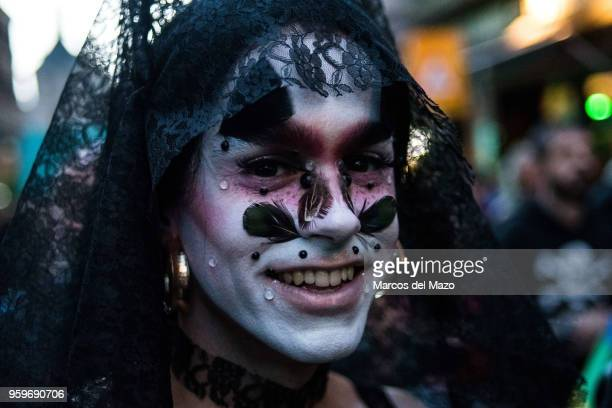 Decorated face posing during the International Day Against Homophobia, Transphobia and Biphobia protesting to demand equality for LGBT community.