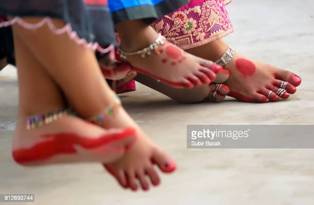 Decorated  feet  with red dye(known as 'Alta') of traditional Indian women.