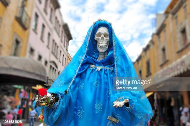 decorated female skeleton on day of the dead holiday in mexico city mexico - mexican fiesta stock pictures, royalty-free photos & images