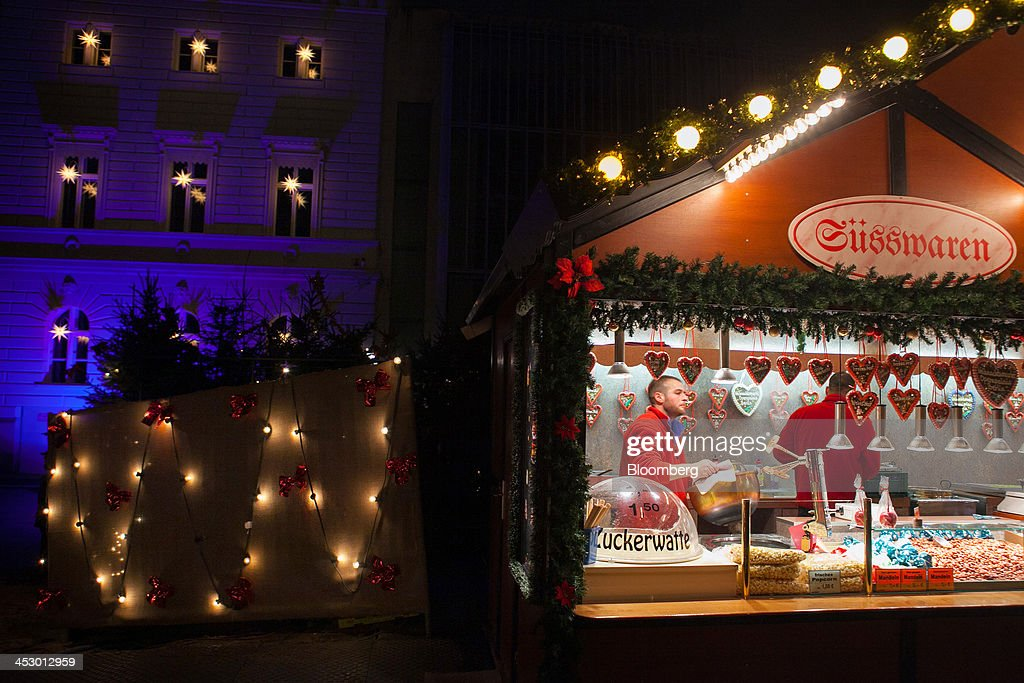 A decorated festive stall stands illuminated at a market ahead of Christmas in Berlin, Germany, on Sunday, Dec. 1, 2013. Euro-area economic growth slowed to 0.1 percent in the third quarter after a 0.3 percent gain in the previous three months. Photographer: Krisztian Bocsi/Bloomberg via Getty Images