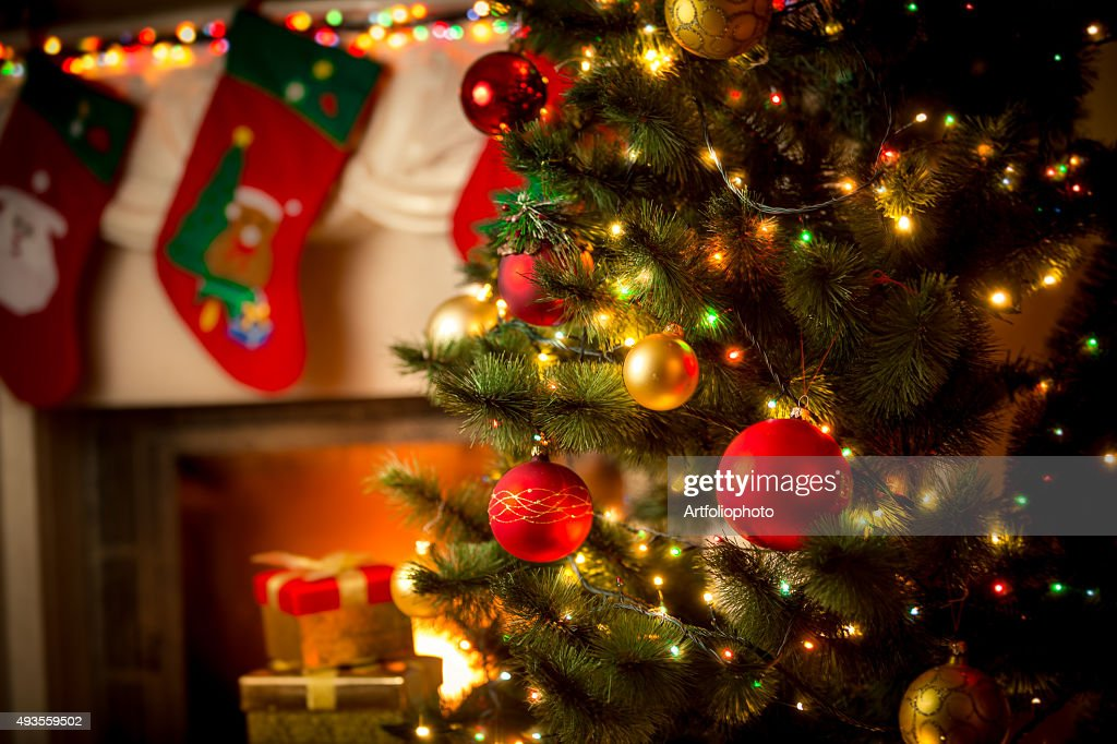 decorated fireplace and Christmas tree at cottage : Stock Photo