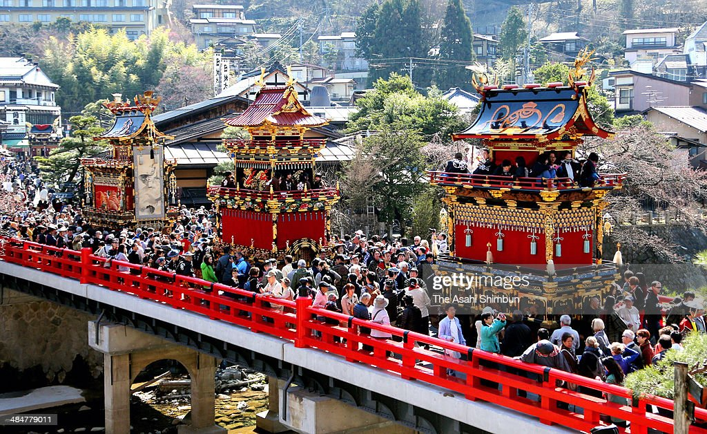 Decorated floats march on to pass the Nakabashi bridge during 'Tennosai', Spring Takayama Festival on April 14, 2014 in Takayama, Gifu, Japan. The festival, thought to be date back in 16th to 17th century, expect to attract 180,000 visitors.