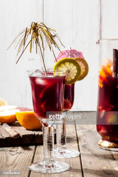 decorated glasses of sangria with fresh fruits - sangria stock pictures, royalty-free photos & images