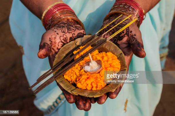 decorated hands holding traditional offering, allahabad, uttar pradesh, india - kumbh mela stock pictures, royalty-free photos & images