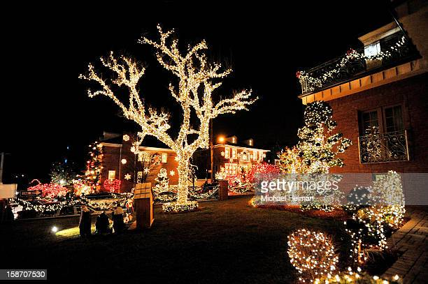 Decorated houses are seen on Christmas Eve December 24, 2012 in the Dyker Heights neighborhood of the Brooklyn borough of New York City. The...
