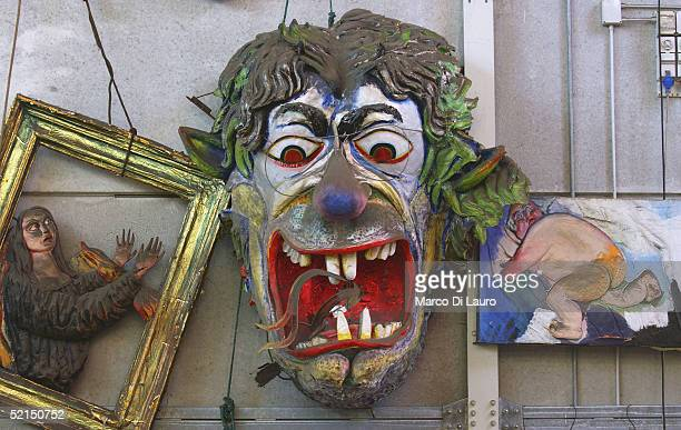 A decorated mask made from papier mache is seen in a hangar at the 'Carnival City' where floats are built on February 4 2005 outside Viareggio Italy...