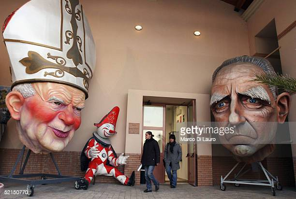 Decorated masks made from papier mache representing Pope John Paul II and Italian President Carlo Azeglio are seen at the entrance of the Museum of...