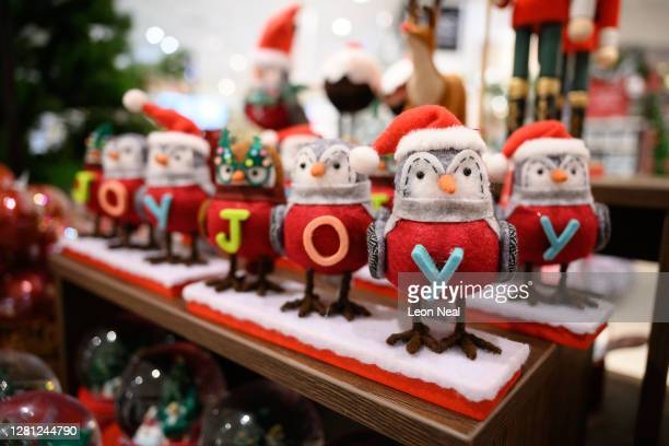 Decorated owls are seen among some of the festive items in the Christmas gift and decoration section in the branch of retailer Marks and Spencer at...