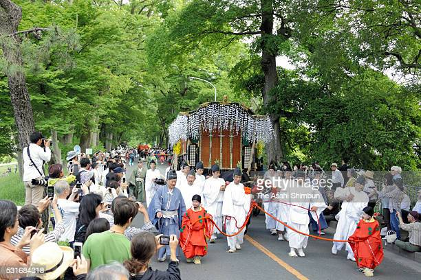 A decorated ox cart march on at the parade during the Aoi Festival at Shimogamo Shrine on May 152016 in Kyoto Japan Aoi Festival is one of the three...