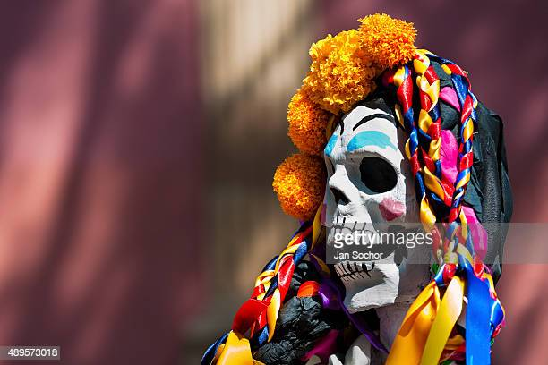 A decorated skeleton figurine is seen at the altar of the dead a religious site honoring the deceased during the Day of the Dead celebration on...