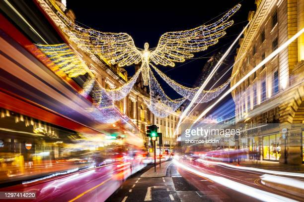 decorated street of london in christmas at night - long exposure stock pictures, royalty-free photos & images