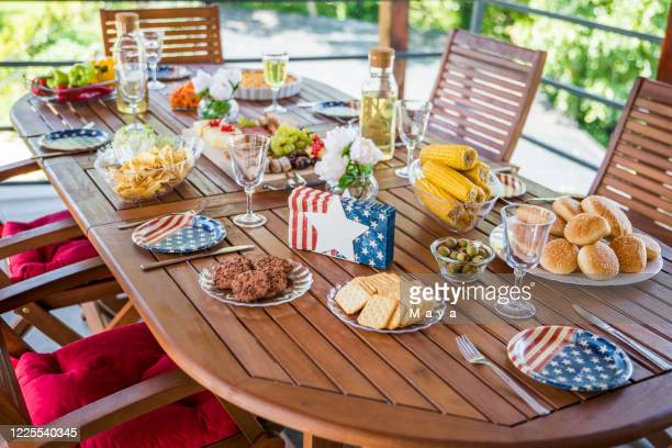 decorated table for celebrating - garden decoration stock pictures, royalty-free photos & images
