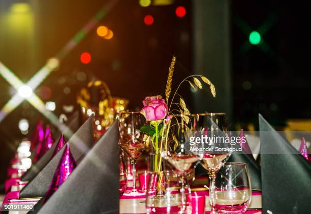 Decorated tables in little restaurant, ready for guests, evening atmosphere
