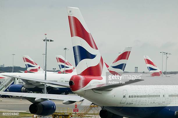 decorated tails of british airways planes - british airways stock pictures, royalty-free photos & images