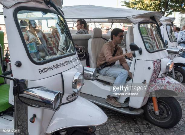 Decorated TukTuks at Miradouro Portas do Sol near the castle of Sao Jorge in Bairro do Castelo neighborhood one of the city's oldest district and a...