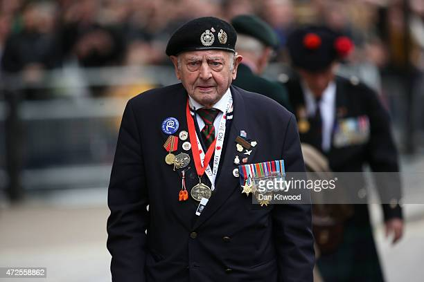 A decorated veteran walks before a tribute at the Cenotaph to begin three days of national commemorations to mark the 70th anniversary of VE Day on...