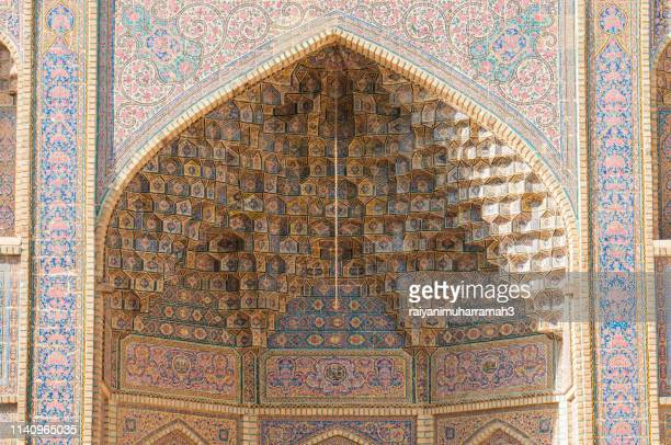 decorated wall of nasir ol-molk mosque, shiraz, fars province, iran - shiraz stock pictures, royalty-free photos & images
