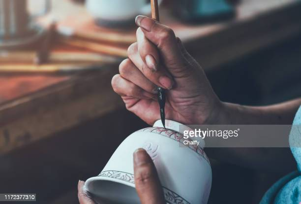decorating a porcelain cup in a factory - porcelain stock pictures, royalty-free photos & images