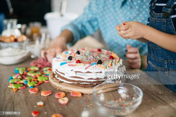 decorating birthday cake - cake decoration stock pictures, royalty-free photos & images
