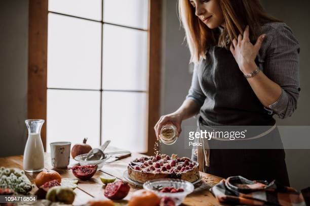decorating blackberry pie using nuts - decorating a cake stock pictures, royalty-free photos & images