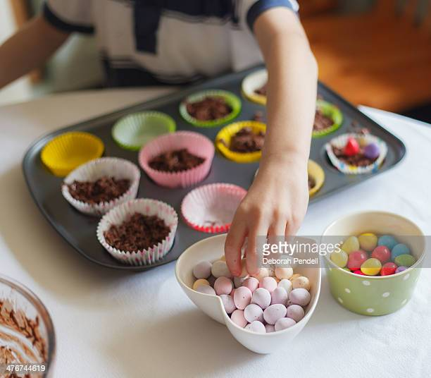 Decorating chocolate cakes with sugar coated eggs