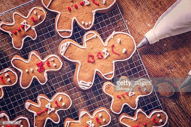 decorating christmas cookies with icing - christmas cookies stock pictures, royalty-free photos & images