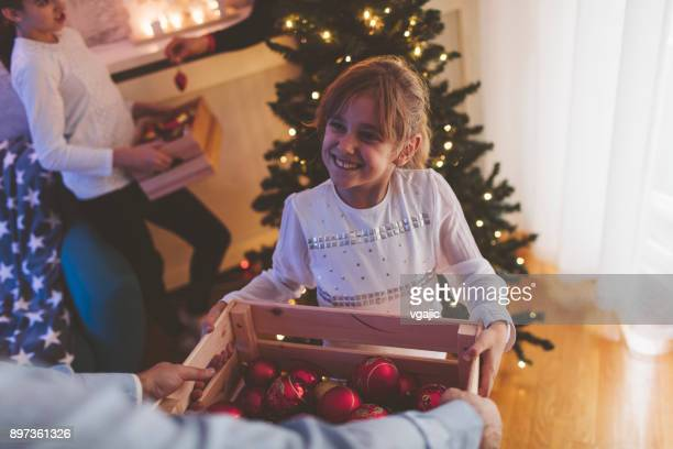 decorating christmas tree - 6 11 months stock pictures, royalty-free photos & images