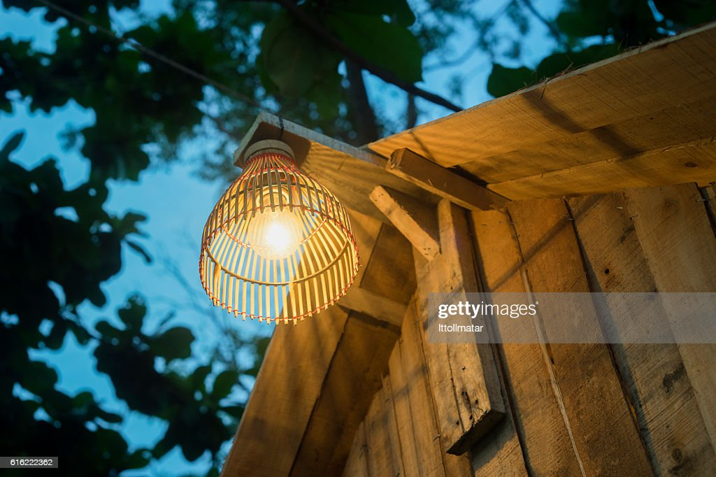 Decorating lantern hanging on wooden bar : Stockfoto