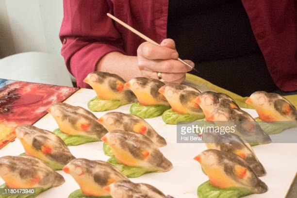 decorating marzipan candy figures - marzipan stock pictures, royalty-free photos & images
