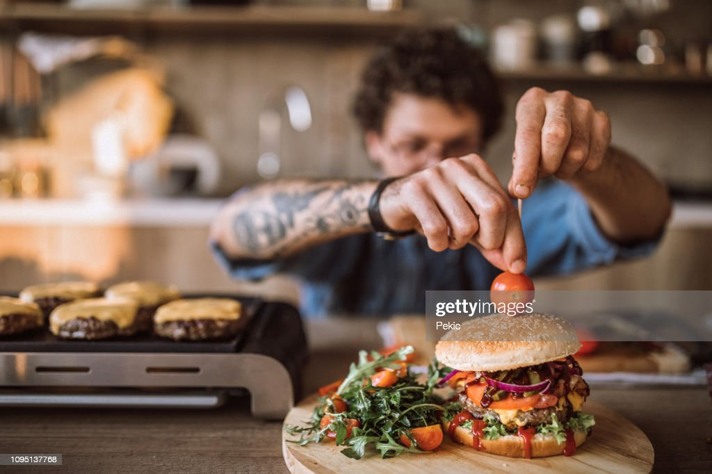 Decorating Tasty Hamburgers : Stock Photo