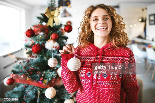 decorating the christmas tree. - christmas jumper stock photos and pictures