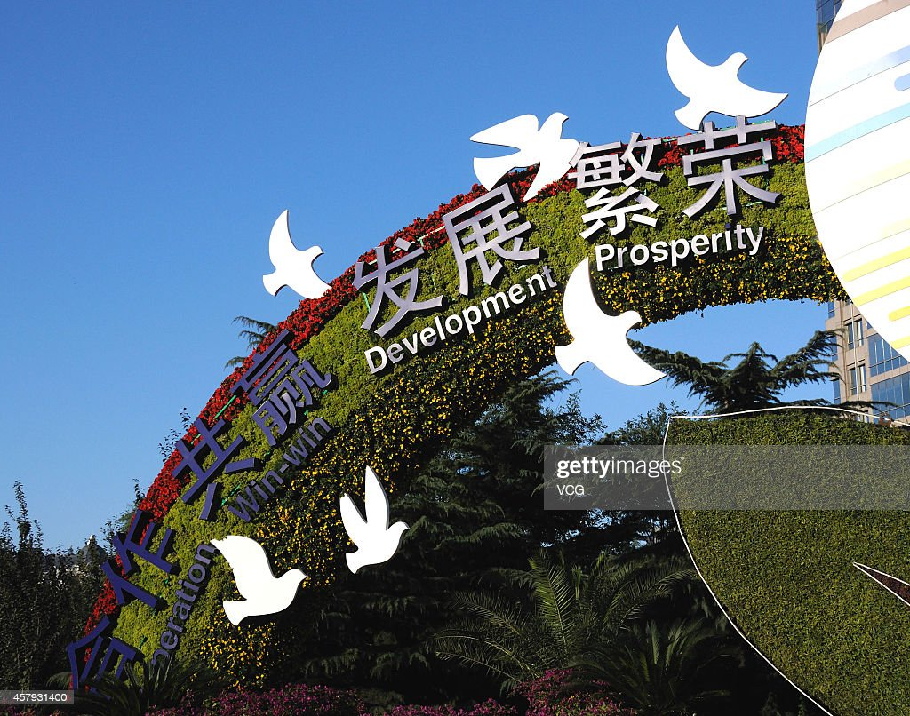 Decoration flowers get together to welcome Asia-Pacific Economic Cooperation (APEC) at Changan Avenue on October 26, 2014 in Beijing, China. Flowers in the themes of 'Harmony and Win-win Result' and 'Peaceful Development' were arranged at Changan Avenue for the upcoming APEC summit on Thursday in Beijing.