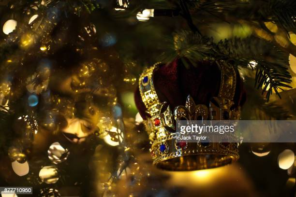 A decoration hangs from 20ft Nordmann Fir tree from Windsor Great Park in St George's Hall which has been decorated for the Christmas period on...