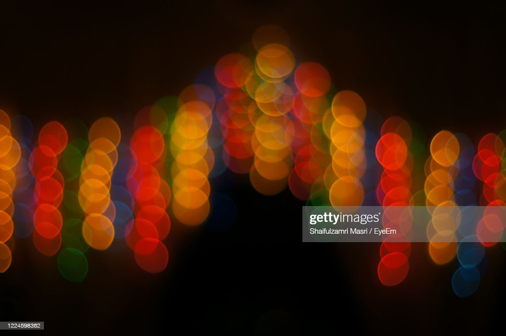Decoration Lamps In Blur Or Bokeh Hanging On The Door With Dark Night As Background : Stock Photo