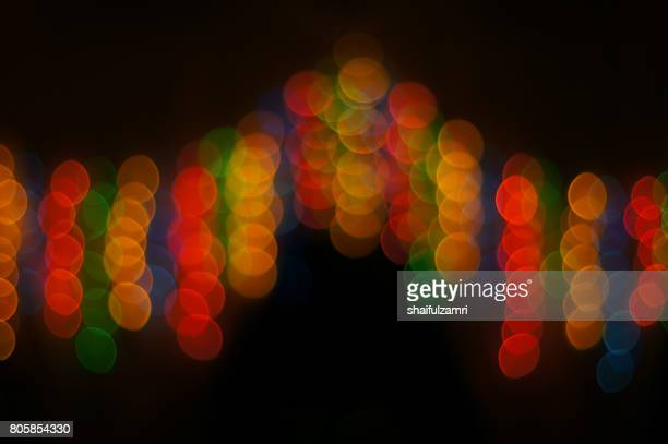 decoration lamps in blur or bokeh hanging on the door with dark night as background - shaifulzamri stock pictures, royalty-free photos & images