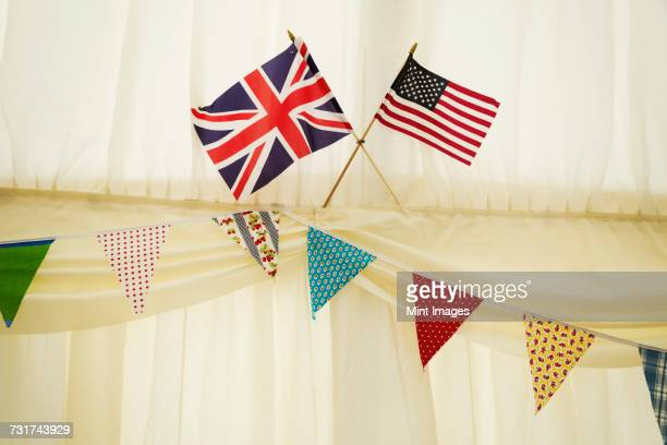Decoration of bunting and English and US flag in a wedding marquee.