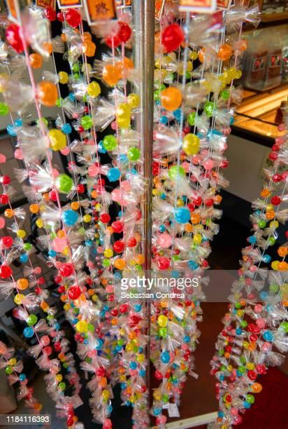decoration of candy on cord, nishiki market, kyoto, japan travel, jr route. - 大福餅 ストックフォトと画像