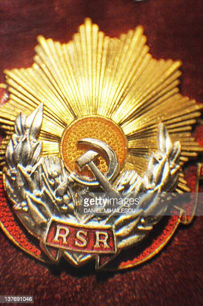 A decoration showing communist ensigns is exhibited at an auction in Bucharest on January 19 2012 The auction is called Golden Age in reference to...