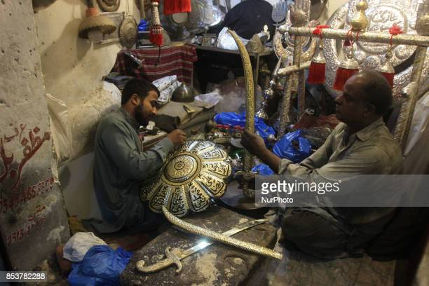 Decoration stuf for the horse of Imam Hussain is being preparing for mourning rituals during the month of MuharramulHaram which is the first month of...