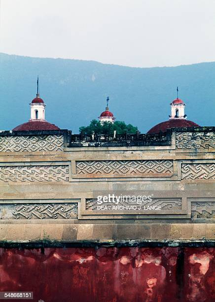 Decoration with geometric motifs and the domes of the Church of San Pablo in the background Mitla Valley of Oaxaca Mexico Zapotec civilisation 7th...