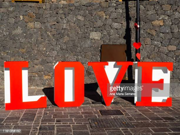 decoration with giant letters forming the word love in the village tejeda of the island of gran canaria, canary islands, spain - love island stock pictures, royalty-free photos & images