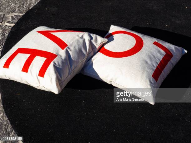 decoration with mattresses and cushions with the text love in the village tejeda of the island of gran canaria, canary islands, spain - love island stock pictures, royalty-free photos & images