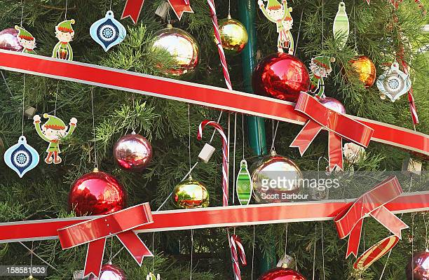 Decorations adorn a large Christmas tree in Christmas Square on December 20 2012 in Melbourne Australia Australian retailers are looking forward to...