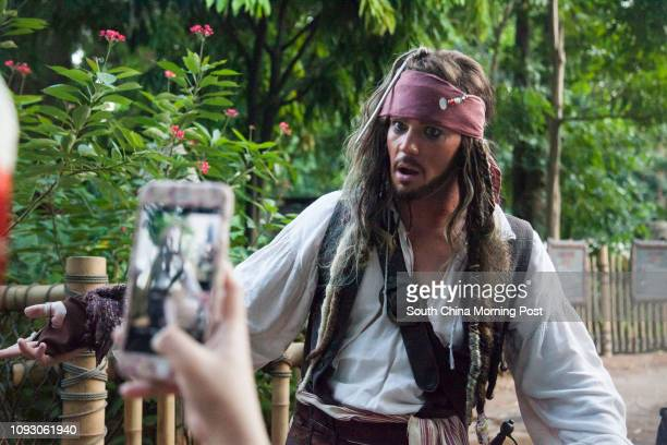Decorations and attractions from 'Disney Halloween Time' themed attractions at Hong Kong Disneyland Captain Jack Sparrow meets guests in the Pirates...
