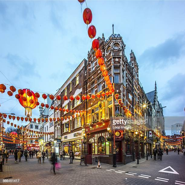 Decorations for Chinese New Year in Wardour Street in London at dusk