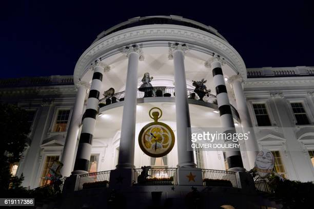 Decorations from Alice in Wonderland are displayed on the White House for halloween on October 29 2016 in Washington DC / AFP / Olivier Douliery