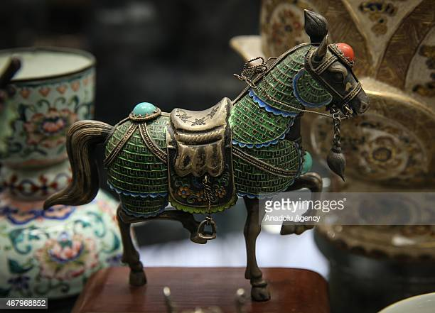 Decorative and fine arts antique furniture and jewelry displayed at the Pier Antique Show which features more than 400 exhibitors at Pier 94 in New...