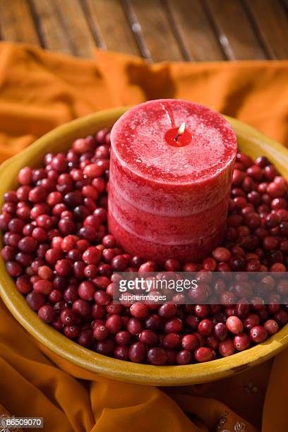 Decorative candle with cranberries