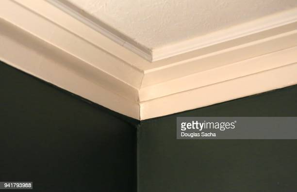 decorative ceiling crown molding intersection - crown molding stock photos and pictures